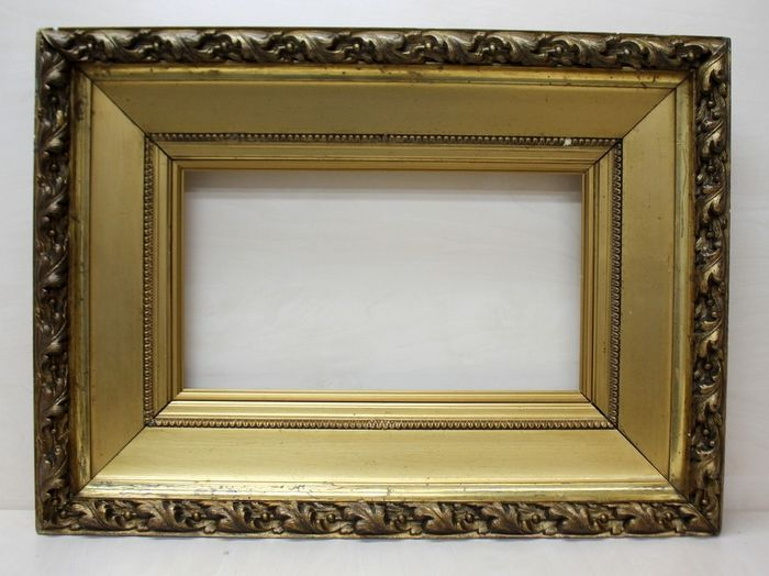A gilded picture frame - Late 19th century
