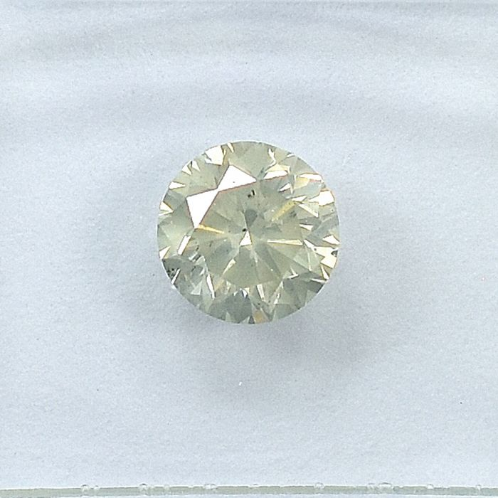 Diamond - 0.70 ct - Brilliant - O-P,Very Light Grayish Yellow - I1 - NO RESERVE PRICE