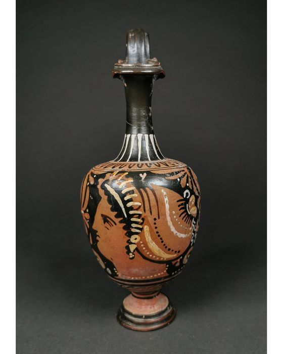 Ancient Greek Terracotta Oinochoe with a Profile Head of the Goddess Niké (goddess of victory) - 23 cm