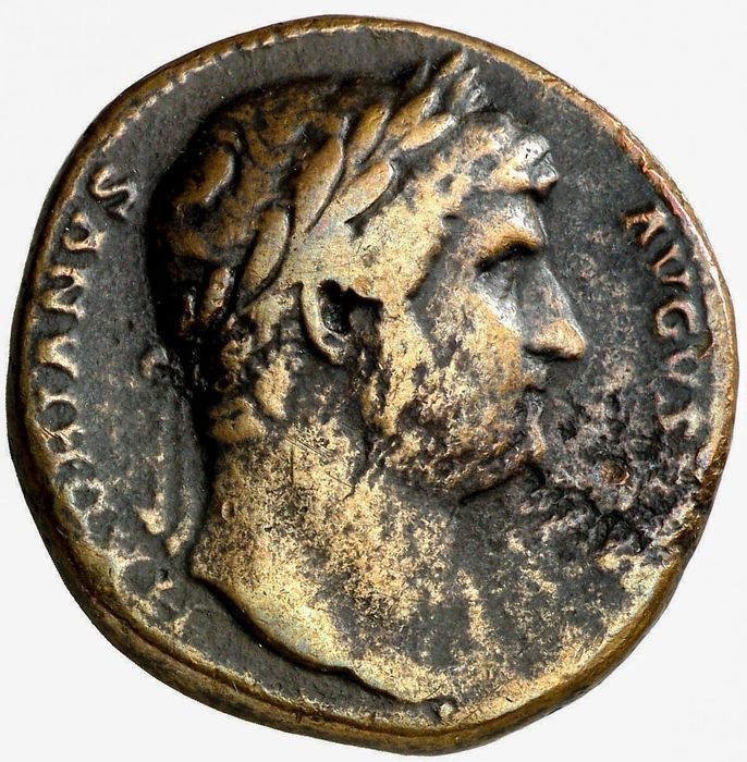 Roman Empire - Sestertius - Hadrian (117-138 A.D.) Roma seated left on cuirass, holding Victory and cornucopiae. - Bronze