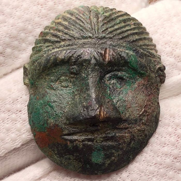 Ancient Celtic Bronze Small Mask with a facing Head of a diademed Male in very Abstractive Style