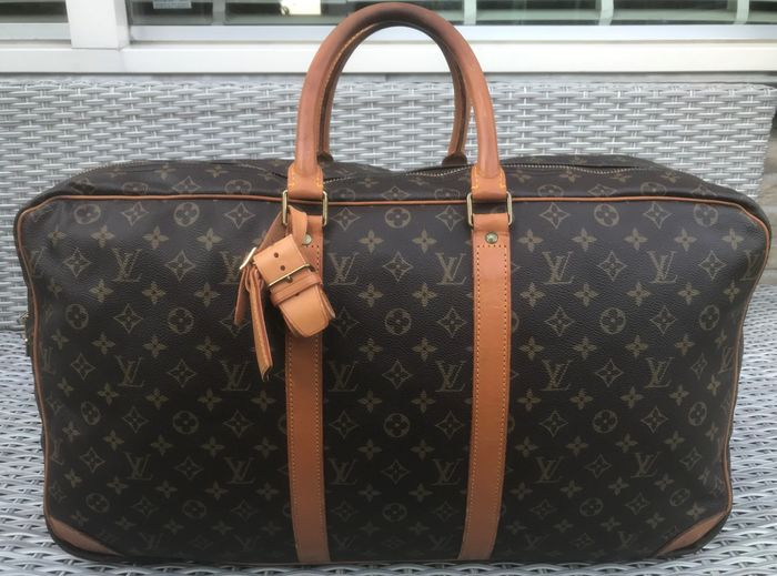 Louis Vuitton - Sirius 55 2 Poches Reistas