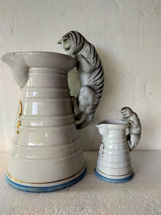 two unique milk jugs with handle as cat 2 pieces (2)