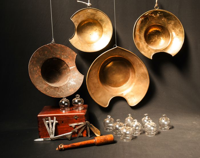 A collection of bloodletting instruments. - Brass, iron, glass, steel, wood, horn and glass.