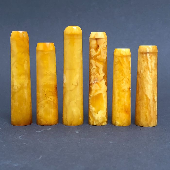Group of six rock amber pipe stems, old factory stock. Ca. 36 grams.
