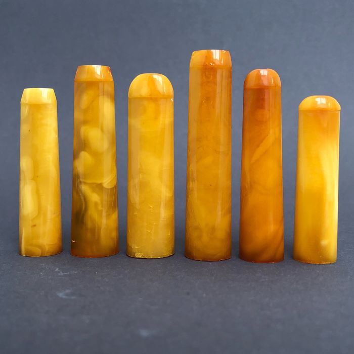 Group of six rock amber pipe stems, old factory stock. Ca. 32 grams.