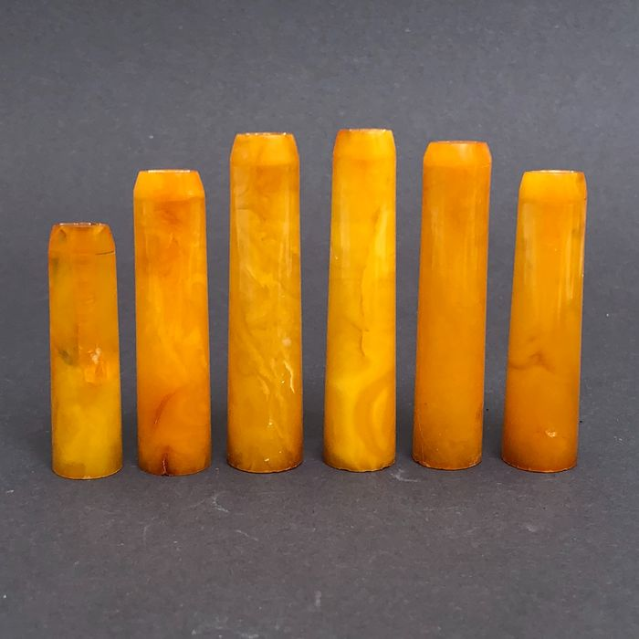Group of six rock amber pipe stems, old factory stock. Ca. 31 grams.