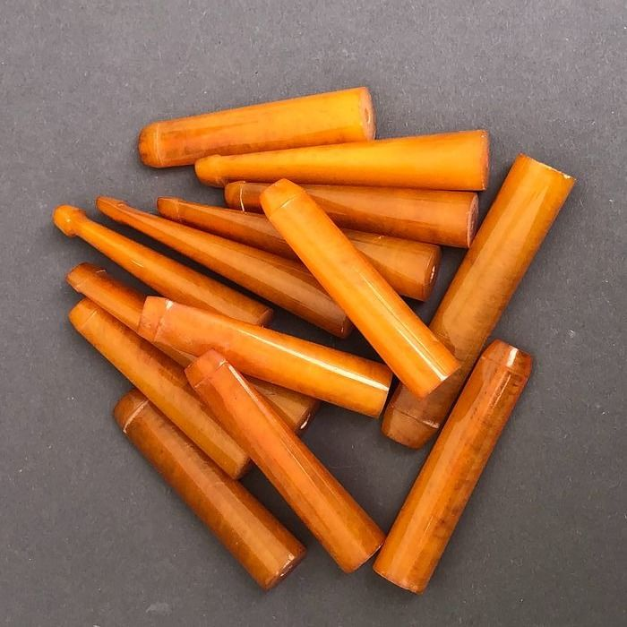 Group of 14 amber pipe stems, old factory stock. Ca. 110 grams