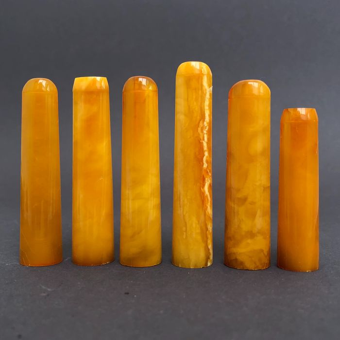 Group of six rock amber pipe stems, old factory stock. Ca. 39 grams.