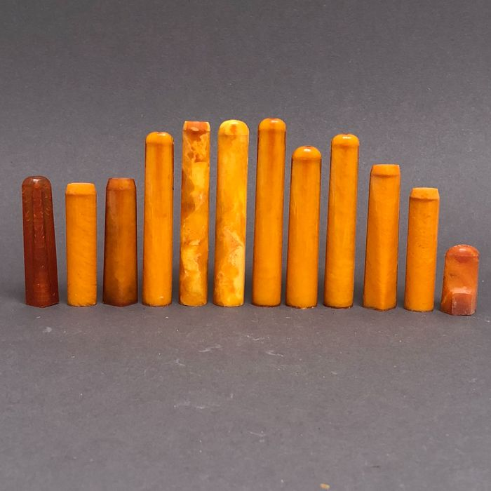 Group of 12  amber pipe stems, old factory stock. Ca. 67 grams