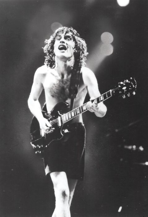 Rolling Stone Records - AC/DC at concert with Angus Young (1982)