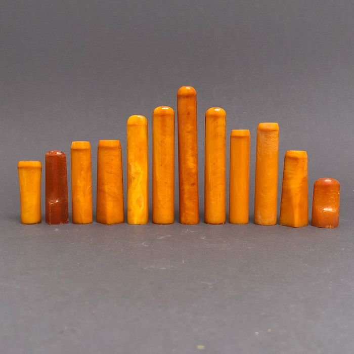 Group of 12  amber pipe stems, old factory stock. Ca. 65 grams