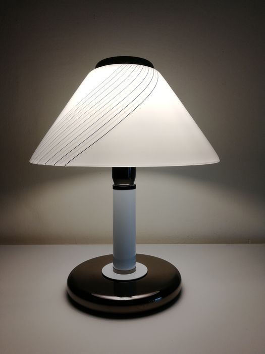 Table lamp in steel and glass