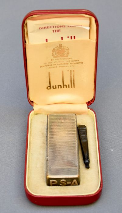Dunhill luxury lighter, made in Switzerland, U.S patented RE24163