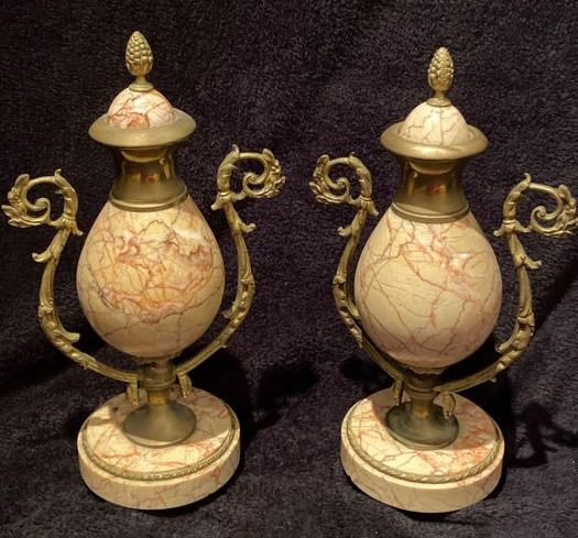 Pair of urns in pink marble