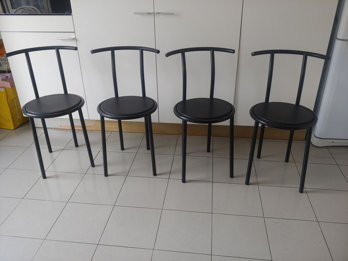 Fly Line - Four black painted metal chairs