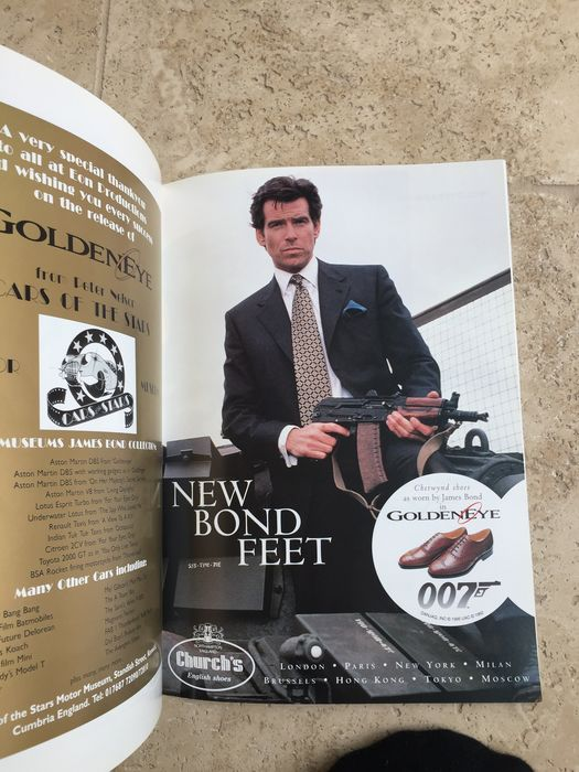 "James Bond - Pierce Brosnan - Lot of 3 -  Goldeneye Royal Premiere Program (UK) &  - German Lobby Card Sets (8) for Tomorrow Never Dies"" & ""The World is Not Enough"""