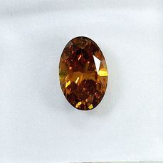 Diamante - 0.58 ct - Ovale - Natural Fancy Deep Orangy Yellow - SI1