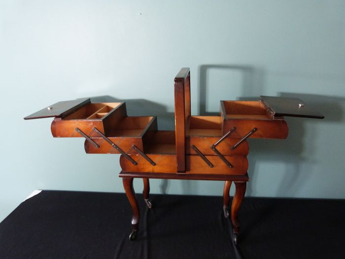 Burr wood sewing box with wheels