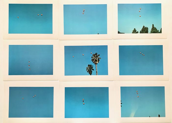 John Baldessari - Throwing three balls in the air to get a straight line