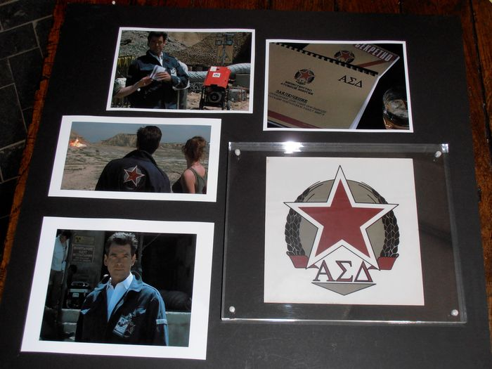 James Bond - The World is Not Enough - Movie Prop - Screen Used Sticker (Logo Russian Company)  - Framed, with COA - Includes 4 scene photos