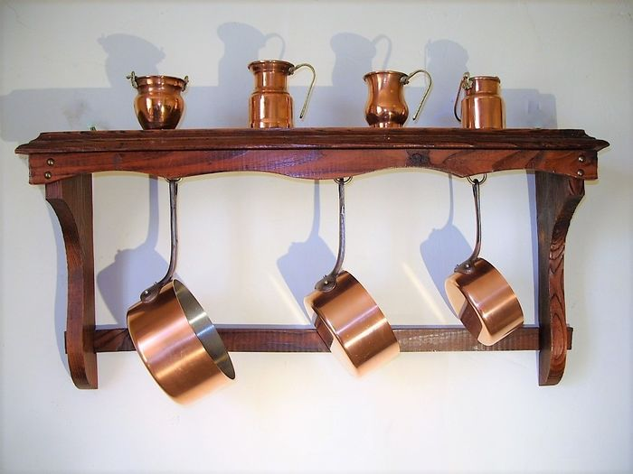 Three solid French pans with pan rack