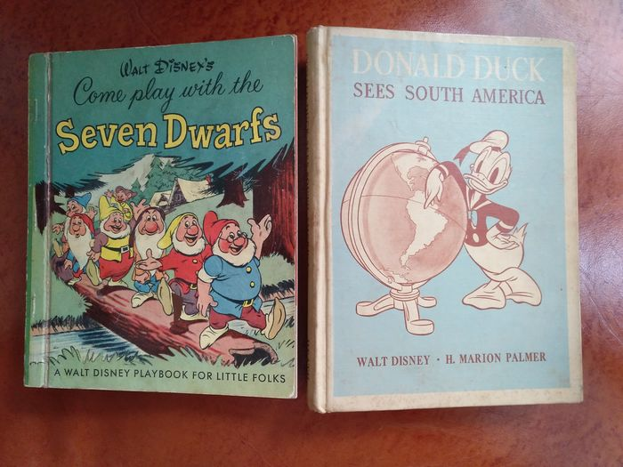 "Walt Disney Story Books - ""Donald Duck Sees South America"" + ""Come play with the Seven Dwarfs"" - Hardcover - Erstausgabe - (1945/1951)"