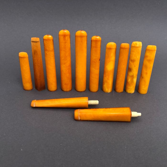Group of 12  amber pipe stems, old factory stock. Ca. 74 grams