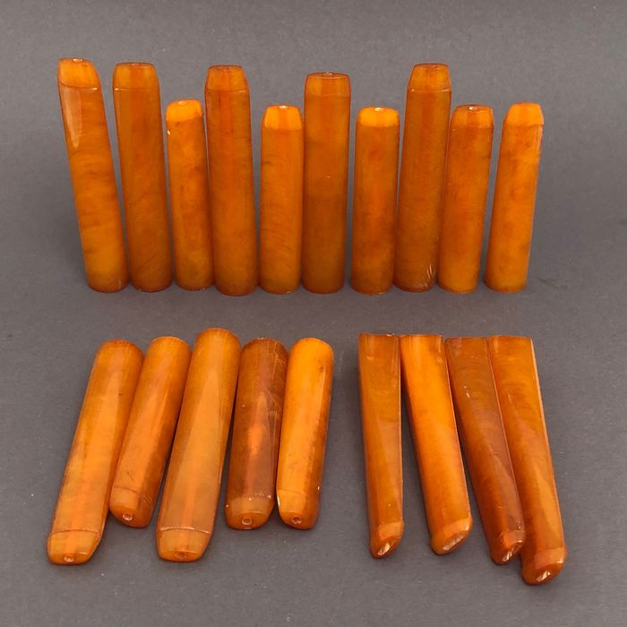 Group of 20  amber pipe stems, old factory stock. Ca. 156 grams