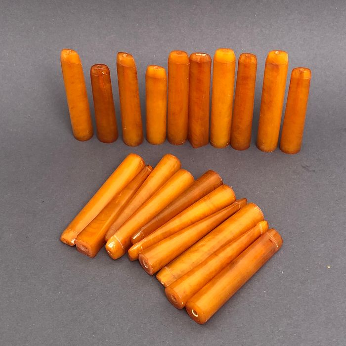 Group of 20  amber pipe stems, old factory stock. Ca. 180 grams