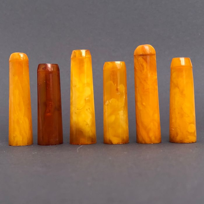 Group of six rock amber pipe stems, old factory stock. Ca. 29 grams.