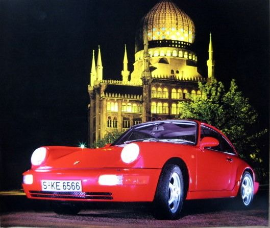 Rare Porscheprint - Porsche 911 Carrera 2 Coupé Red photographed in a beautiful setting