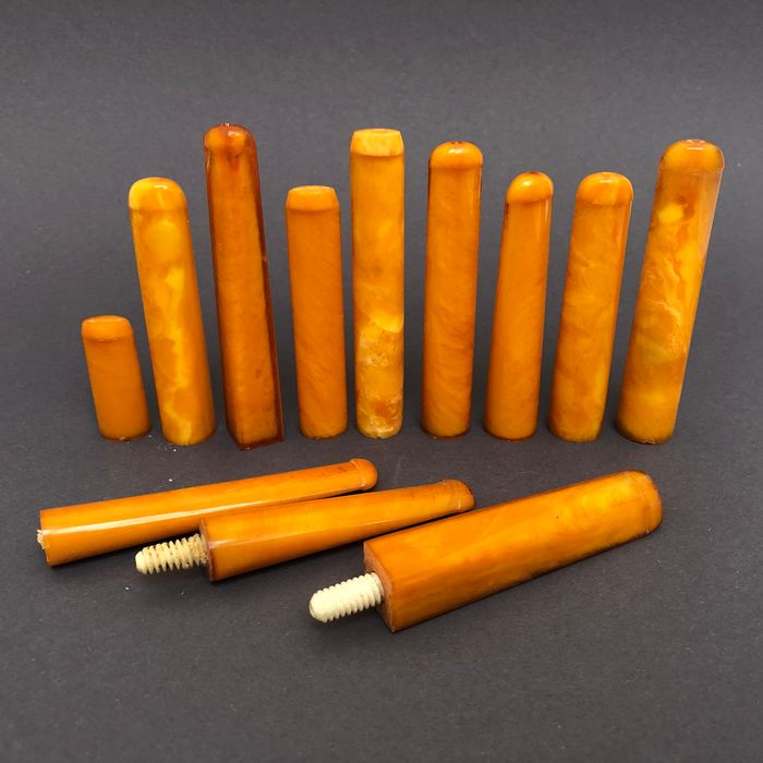 Group of 12  amber pipe stems, old factory stock. Ca. 75 grams