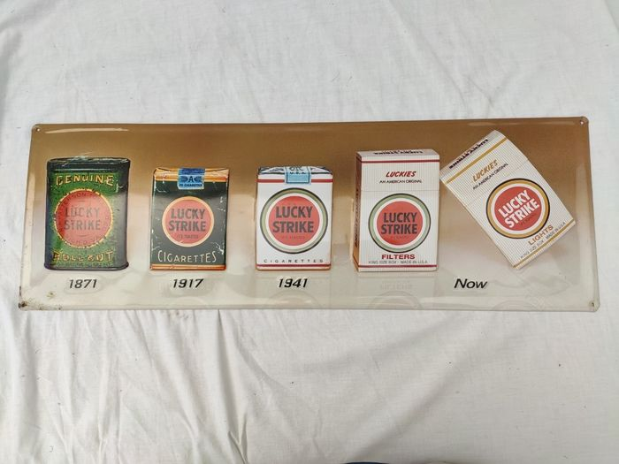 Old advertising sign Lucky Strike - embossed metal plate