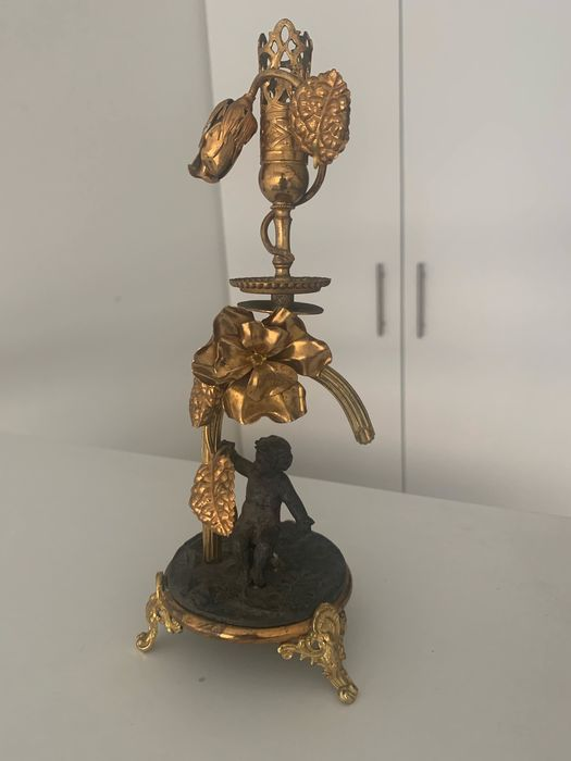 Candlestick, with putto