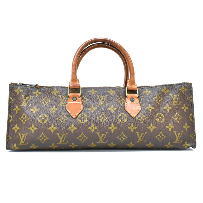 Louis Vuitton - Sac Triangle Sac à main