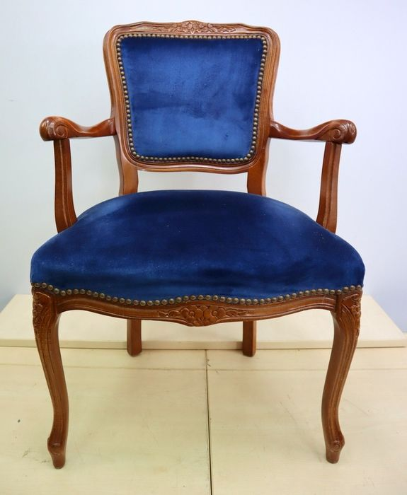 Classic armchair with blue upholstery