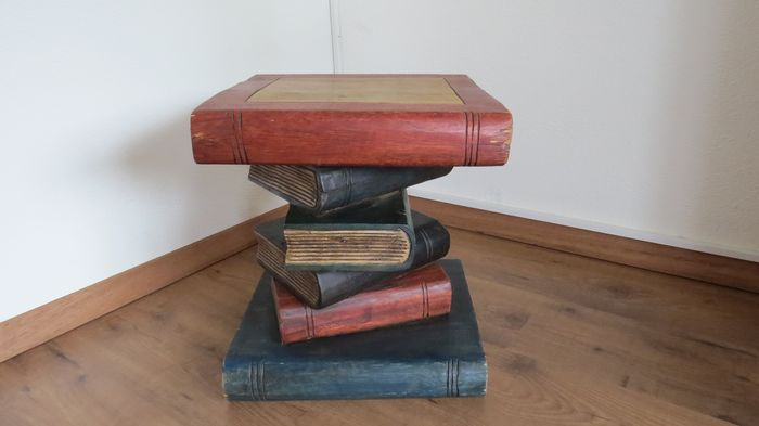 Table of criss-cross stacked solid wood books