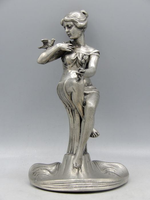 C. Kurz & Co, Tiel - A fine pewter sculpture of a girl with a bird on her arm, dated 1934