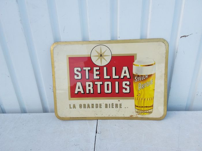 Old advertising board Stella artois. (1) - glass-coated can.