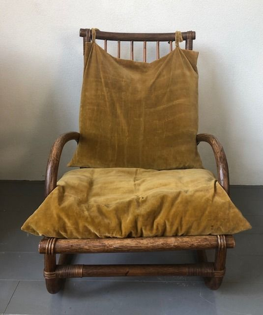 A bamboo armchair with yellow velvet upholstery