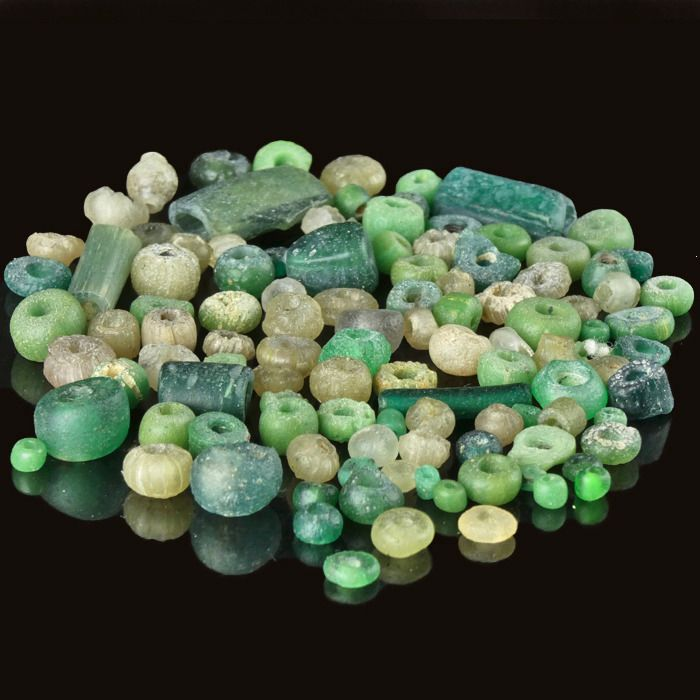 Ancient Roman Glass Collection of ± 100 green and semi-translucent glass beads