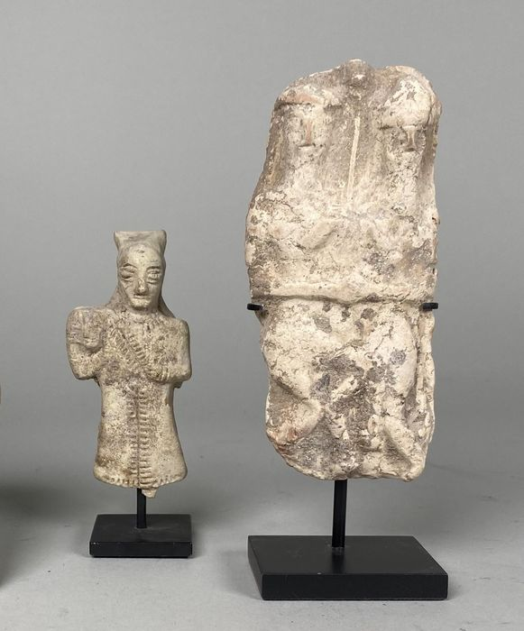 Mesopotamian Terracotta Statuettes of a Worshiper and two Bearded Gods