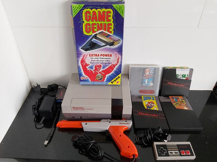 Nintendo NES (NESE-001) + 4 Games (Like Donkey Kong Classics) + Game Genie + Zapper - Console with games