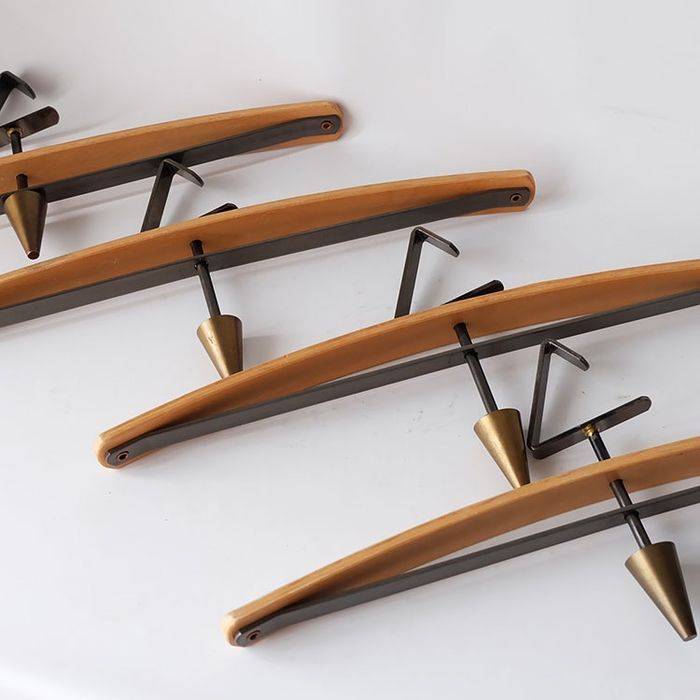 Four separate designer coat hangers.