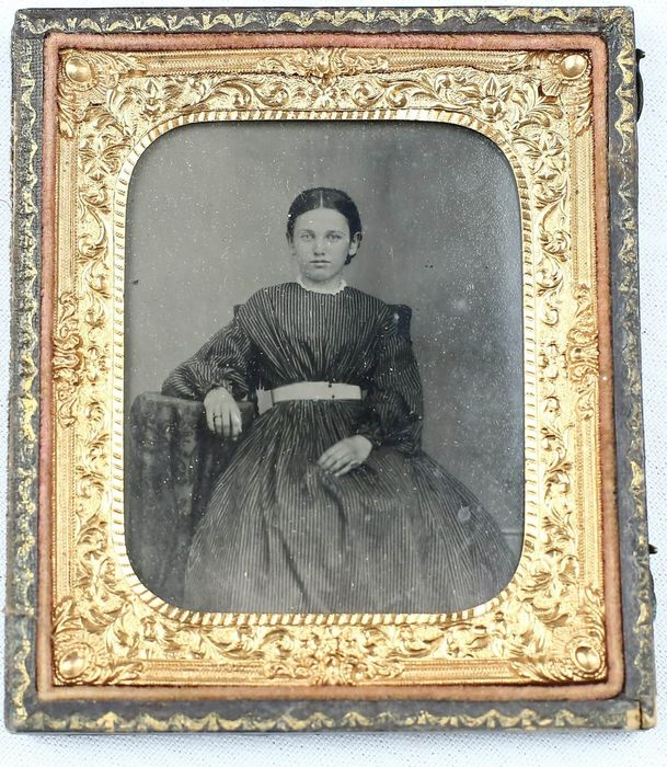 . Fine quality ferrotype housed in half leather case of a girl. 19th century