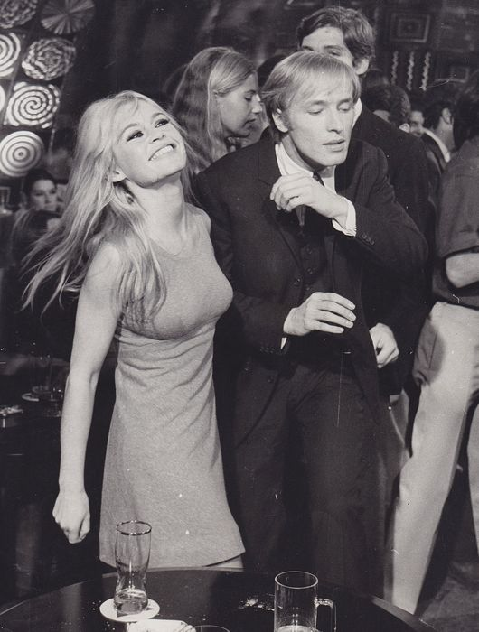 Unknown - Brigitte Bardot and Mike Sarne at a party, 1966