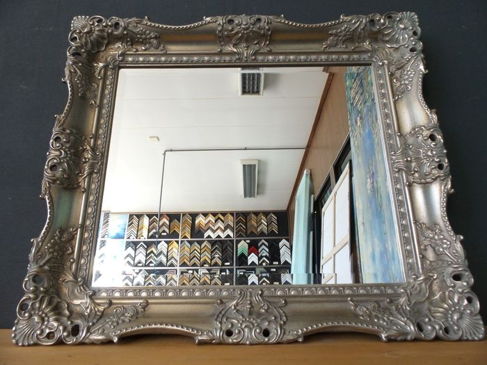 Mirror with faceted cut glass