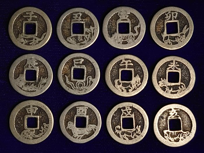 China. AE Amulet / Charm coin set of 12 coins 'the Chinese Zodiac'