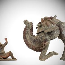 """Mingqi - of """"Vessels for Ghosts"""" - Terracotta - Extremely Rare Large Pottery Crouching Bactrian Camel and Foreign Groom, TL test - China - Tang Dynasty (618-907)"""